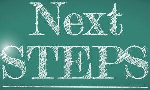 next steps message written on a chalkboard. illustration design