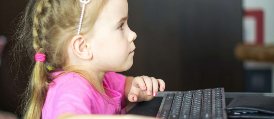 young girl at computer testin a offer on Facebook